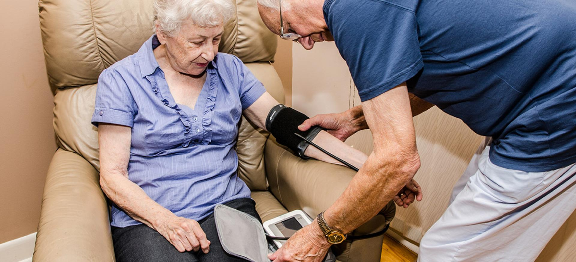older couple checking blood pressure